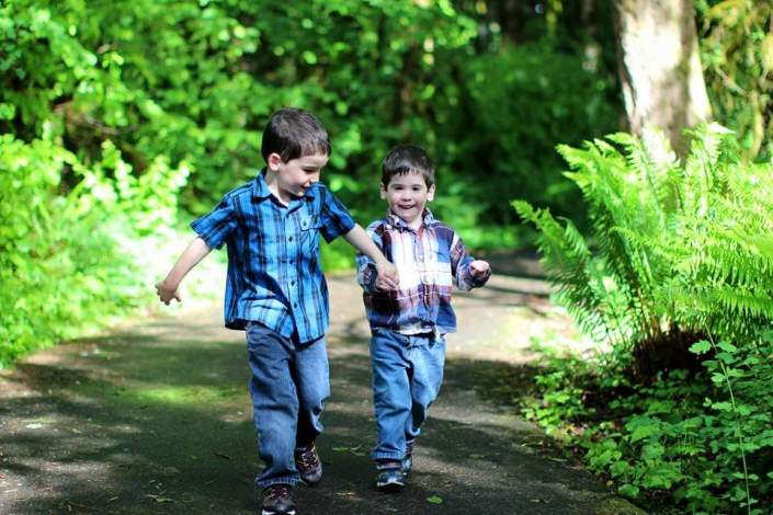 Henry and Owen walking in park